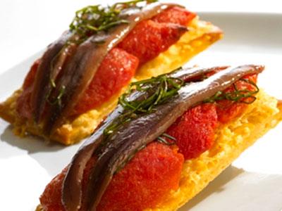 Anchoas del Cantábrico con pan de cristal